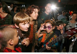 photo of 13 year-old bassist Heather Phillips and her mom surrounded by kids and parents at 12 Galaxies in San Francisco - photo by Michael Macor, San Francisco Chronicle